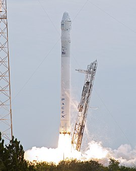A Falcon 9 v1.0 launches with an uncrewed Dragon spacecraft