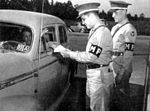 Spence Army Airfield -MP checking Vehicle before access.jpg