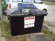 "A large bin, with ""GREASE ONLY"" stamped on the lid."