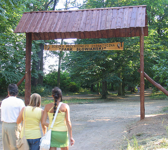 A family entering the Slavic Park in Sprottau, Poland. Parks and green spaces can improve people's quality of life.