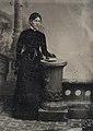 Standing woman in black, ca. 1856-1900. (4732548208).jpg