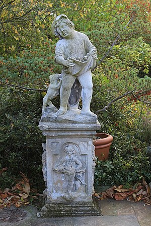 Edward Augustus Bowles - Statuette of a young boy holding apron with puppies (The lake terrace)
