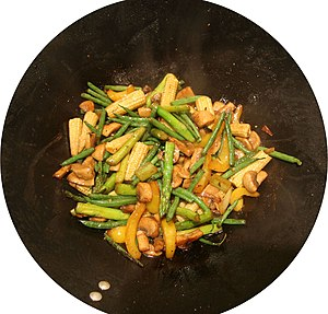 Stir frying - Ingredients are typically added in succession after cooking oil has been applied onto a hot pan. The ingredients that take longest to cook, like meat or tofu, are added before others, such as vinegar and soy sauce.