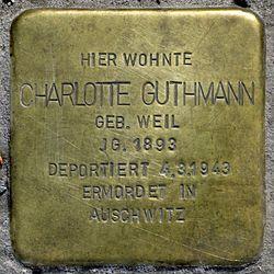 Photo of Charlotte Guthmann brass plaque