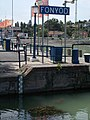 Street lights, sign, water gauge at ship station, Port of Fonyód, 2016 Hungary.jpg