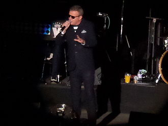 Suggs (singer) - Suggs performing live with Madness at Manchester Arena, 2014