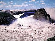 The reservoir emptying through the failed Teton Dam.