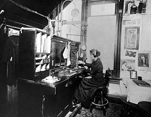 Telephone switchboard - Telephone operator, c. 1900.