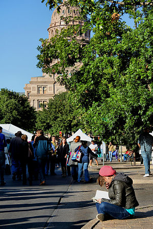 Texas Book Festival - A person reading a book at the 2012 Texas Book Festival.