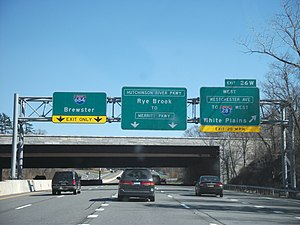 Hutchinson River Parkway - The Hutchinson River Parkway northbound approaching exit 26W, the Cross Westchester Expressway in Harrison. Signage for the upcoming junction of I-684 is present