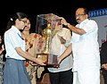 The Minister of State (Independent Charge) for Consumer Affairs, Food and Public Distribution, Professor K.V. Thomas presenting the trophy to Rupal Kalra, at the 'Hum Kishore Festival', festival of school children.jpg