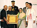The President, Smt. Pratibha Devisingh Patil presenting the Fakhruddin Ali Ahmed Award-2006 to the noted journalist Shri Shekhar Gupta, in Guwahati on October 19, 2008.jpg