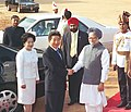 The President of Republic of Korea Mr. Roh Moo-Hyun shakes hands with the Prime Minister Dr. Manmohan Singh in New Delhi on October 05, 2004.jpg