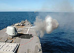 The guided missile destroyer USS Curtis Wilbur (DDG 54) fires an Mk 45 lightweight gun at a BQM-74 target drone during a live-fire exercise as part of Cooperation Afloat Readiness and Training (CARAT) 2013 130608-N-AX577-219.jpg