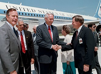T. Jack Lee - President George H. W. Bush and Alabama Governor Guy Hunt are greeted by Thomas J. Lee on their arrival at Redstone Arsenal airfield, June 20, 1990.