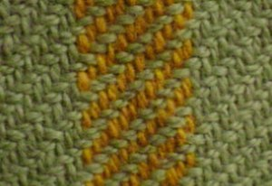 Twill - A twill weave can be identified by its diagonal lines. This is a 2/2 twill, with two warp threads crossing every two weft threads.
