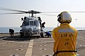 Two MH-60s land aboard USS Comstock 141220-M-RR352-078.jpg