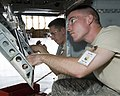 U.S. Air Force Airman Basic Kyle King and Airman 1st Class Ian Tanafon, both with the 364th Training Squadron, practices removing and installing hydraulic components on a T-38 Talon aircraft at Sheppard Air 110923-F-NF756-011.jpg