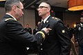 U.S. Army Maj. Gen. Bryan Kelly, left, the commanding general of Army Reserve Medical Command, presents the Army Commendation Medal to Spc. James Freitas after naming him Noncommissioned Officer of the Year 130329-A-DB144-1391.jpg