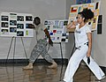 U.S. Army Master Sgt. James Cork, left, an equal opportunity advisor for U.S. Army South, participates in a Capoeira martial arts demonstration during a Hispanic Heritage Month Celebration in San Antonio, Texas 111011-A-GG454-031.jpg