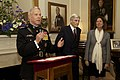 U.S. Marine Corps Gen. James F. Amos, left, the commandant of the Marine Corps, speaks during a reception in honor of retired U.S. Sen. John Warner, center, the Evening Parade guest of honor and a former 130503-M-LU710-157.jpg