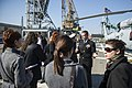 U.S. Navy Cmdr. Andrew Biehn, second from right, the commanding officer of the guided missile destroyer USS Truxtun (DDG 103), gives a tour of the ship to the media following a multilateral exercise with Romania 140314-N-EI510-132.jpg