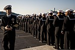 U.S. Navy Command Master Chief Shaun Brahmstead, left, watches Sailors as they man the rails on the flight deck of the aircraft carrier USS George Washington (CVN 73) as the ship arrives in Busan, South Korea 131004-N-BD107-079.jpg