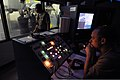 U.S. Navy Machinist's Mate 1st Class Donald Maloney, right, monitors the instructor operating station while Sailors with the Executive Leadership Development Program battle leaks in the damage control wet 140113-N-RC734-082.jpg