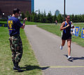 U.S. Navy Petty Officer 1st Class Mark Allen, left, keeps time for a runner at the Navy SEAL Fitness Challenge in Dearborn, Mich., May 10, 2008 080510-N-TG958-001.jpg