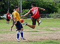 U.S. Sailors assigned to the guided missile destroyer USS John S. McCain (DDG 56) and Philippine marines compete in a soccer match in Subic Bay, Philippines, July 1, 2014, during Cooperation Afloat Readiness 140701-N-YU572-073.jpg