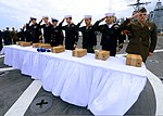 U.S. Sailors salute the remains of Navy and Marine Corps veterans during a burial at sea aboard the amphibious dock landing ship USS Carter Hall (LSD 50) in the Atlantic Ocean March 18, 2013 130318-N-XZ031-085.jpg