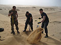 U.S. Service members assigned to high speed vessel Swift (HSV-2) dig a hole for a fence post during a community service project at the Walvis Bay district damara tern breeding ground in Walvis Bay, Namibia 120522-N-JL721-031.jpg
