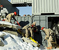U.S. Service members with the Chemical, Biological, Radiological, Nuclear and High-Yield Explosive Enhanced Response Force Package (CERFP), Oregon National Guard and the CERFP, Hawaii National Guard remove 140330-Z-CH590-866.jpg