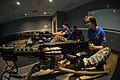 U.S. Soldiers' spouses sit in firing position behind M2 weapon trainers in the Engagement Skills Trainer 2000 facility during Aviation Spouses Day at Fort Rucker 130607-A-SM724-143.jpg