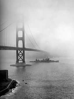The USS San Francisco steams under the Golden Gate Bridge in 1942, during World War II. USS San Francisco (CA-38) enters San Francisco Bay, December 1942.jpg