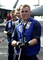 US Navy 020924-N-9593M-050 Three Seaman assigned to Deck Division serve as line handlers during a underway replenishment at sea (UNREP) with the Fast Combatant Support ship USS Camden (AOE-2).jpg