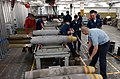 US Navy 030129-N-5362F-003 Aviation Ordnancemen assemble a 500-pound GBU-12 bomb.jpg