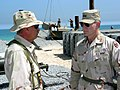 US Navy 030402-N-1050K-032 Capt. Donald P. Cook, Commander, Camp Patriot, describes the process and function of the Elevated Causeway System (ELCAS) modular structure to Maj. Gen. David Kratzer, Commanding General, 377th Theate.jpg