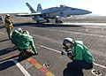 US Navy 040219-N-4374S-009 Photographer's Mate 3rd Class Christian Weibull captures video images of the flight deck personnel during operations.jpg