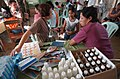 US Navy 040226-N-4142G-006 U.S. Army Capt. Sara Anderson examines a child in Bargangay San Miguel during the Medical Civic Action Program (MEDCAP) being conducted during Exercise Balikatan 2004.jpg
