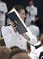 US Navy 040528-N-9693M-019 Newly commissioned Ensign Garrettson Blight displays his degree to family and friends in the crowd during the U.S. Naval Academy class of 2004 graduation and commissioning ceremony.jpg