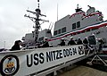 US Navy 050305-N-9013W-004 Sailors board the U.S. Navy's newest Arleigh Burke-class guided missile destroyer USS Nitze (DDG 94) as they bring her to life, during the ship's commissioning ceremony.jpg