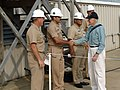 US Navy 050811-N-1433S-017 Former President Jimmy Carter shakes hands with Chief Hospital Corpsman Michael Amador prior to departure for an overnight embark aboard the Sea Wolf-class attack submarine USS Jimmy Carter (SSN 23).jpg