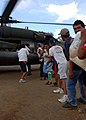 US Navy 051015-N-5526M-020 Victims of Hurricane Stan in Guatemala form long lines helping to move food, water, and medicine off a U.S. Army UH-60 Blackhawk helicopter.jpg