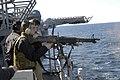 US Navy 060316-N-6482W-044 Gunners Mate 3rd Class Thomas Madden stationed aboard the amphibious assault ship USS Bataan (LHD 5) shoots an M-60 machine gun, during live fire qualifications.jpg