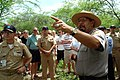 US Navy 060316-N-9643K-001 National Park Service Ranger Daniel Martinez addresses a group of Sailors from the Pearl Harbor Surface Navy Association (SNA) at the site of the USS Arizona relics.jpg