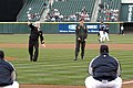 US Navy 060406-N-2746V-097 Navy Region Northwest Sailor of the Year Hospital Corpsman 1st Class Ed Call, throws out the first pitch to Seattle Mariners relief pitcher Julio Mateo.jpg