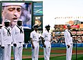 US Navy 060428-N-7517M-016 Musician 3rd Class Phil Stacey assigned to Navy Band Southeast sings the National Anthem prior to an Atlanta Braves game at Turner Field.jpg
