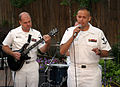 US Navy 060522-N-2908O-001 Navy Band Mid-South Lead singer Musician 3rd Class Spencer Haasenritter and base guitarist Musician 2nd Class Austin Alley perform live on-air for the local CBS affiliate KTHV-TV Morning show.jpg