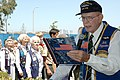 US Navy 060529-N-1159B-042 Caller of the Boats Bill Hagendorn reads off the list of U.S. Navy submarines lost during World War II and the Cold War as wives of U.S. submarine veterans line up to toss flowers into a reflecting po.jpg